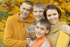 Happy family in autumn forest Stock Photos