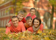 Happy family in autumn forest Stock Image