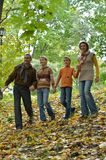 Happy family in autumn forest walking Royalty Free Stock Images