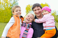 Happy family in autumn park Stock Image