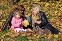 Happy family in autumn park. Outdoor Stock Photography