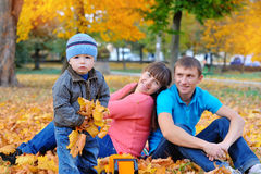 Happy family in autumn park.  Stock Image