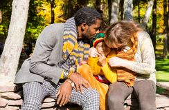 Happy family in autumn park. African American family: black father, mom and child boy on nature in fall. Royalty Free Stock Photos