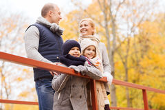 Happy family in autumn park Royalty Free Stock Images