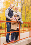 Happy family in autumn park Royalty Free Stock Image
