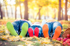 Happy family in autumn park. Happy family having fun outdoors in autumn park Royalty Free Stock Photography