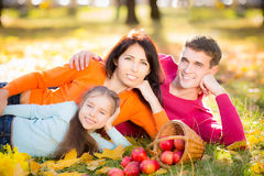Happy family in autumn park. Happy family having fun outdoors in autumn park Stock Photography