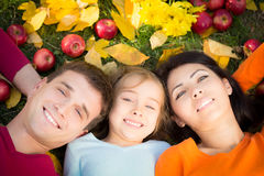 Happy family in autumn park. Happy family having fun outdoors in autumn park. Top view portrait Stock Photography