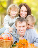 Happy family in autumn park Stock Photos