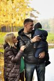 Happy family in autumn park near lake.  Royalty Free Stock Photography