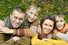 Happy family in the autumn park Stock Image