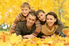 Happy family in the autumn park Royalty Free Stock Image