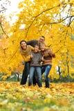 Happy family in the autumn park Royalty Free Stock Photo