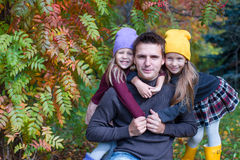 Happy family in autumn park outdoors Stock Photography