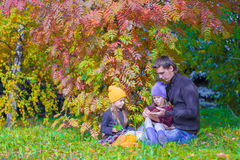 Happy family in autumn park outdoors Stock Image
