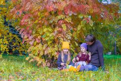 Happy family in autumn park outdoors Royalty Free Stock Photos
