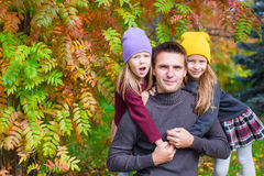 Happy family in autumn park outdoors Stock Photos