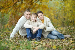 Happy family in autumn park. Portrait of a happy family in autumn park Stock Image