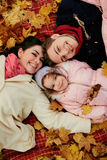 Happy family in autumn in the park. View from above Royalty Free Stock Photo