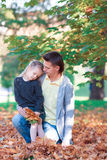 Happy family in autumn park at warm day Stock Photo