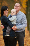 Happy family in autumn park Stock Photo