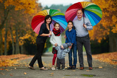 Happy family in autumn park. On yellow leaves Royalty Free Stock Photos