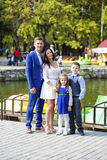 Happy family in autumn park. Young happy family in autumn park Royalty Free Stock Photos
