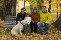 Happy family  at autumn time Stock Images