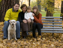 Happy family at autumn time Royalty Free Stock Photo