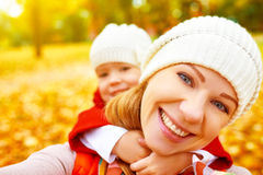 Happy family on autumn walk is photographed doing SELF Stock Photos