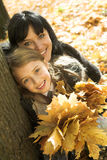 Happy family in an autumnal park Stock Photo
