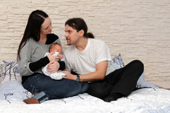 Happy family with a baby royalty free stock image