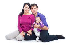 Happy family with a baby Stock Photos