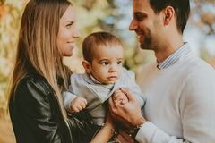 Happy family with baby boy in autumn park Royalty Free Stock Photography