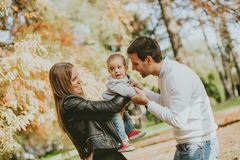Happy family with baby boy in autumn park royalty free stock photo