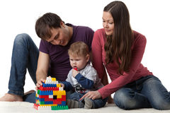 Happy family with  baby build house. Stock Photo