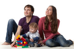 Happy family with  baby build house. Stock Photos