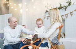 Happy family with baby cheerfully spend house time Royalty Free Stock Images