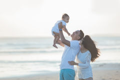 Happy family and baby enjoying sunset in the summer leisure Royalty Free Stock Photography