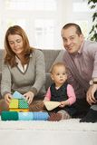 Happy family with baby girl Stock Image