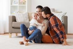 Happy family with baby having fun at home stock images