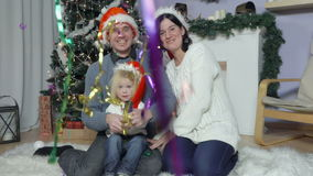 Happy family with baby in Santa`s hats stock video
