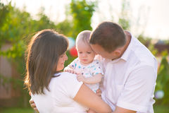 Happy family with baby son in park Royalty Free Stock Images