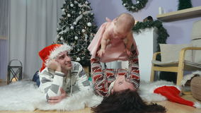 Happy family with baby under the Christmas tree stock footage