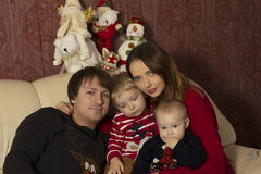 Happy family with baby under decorated Christmas Tree, gifts Royalty Free Stock Photo