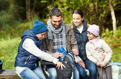 Happy family with backpack and thermos at camp Stock Image