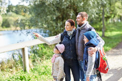 Happy family with backpacks hiking royalty free stock photography
