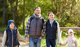 Happy family with backpacks hiking stock photos