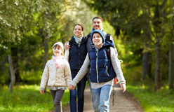 Happy family with backpacks hiking stock image