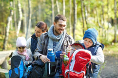 Happy family with backpacks and thermos at camp Royalty Free Stock Photos
